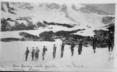 A long line of men coming down out of the mountains stare out at you. The man at the end of the line in the picture is identified with the letters JMS.