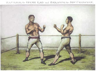 Belasco is upon the right with sideburns. Randall is on the left with lighter hair. They both wear nothing but knickerbocker breeches and sashes girdling the waist.